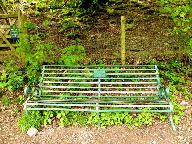 Iron seat with plaque dated 1897