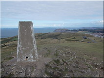 SH7683 : Llandudno: trig point atop Great Orme by Chris Downer