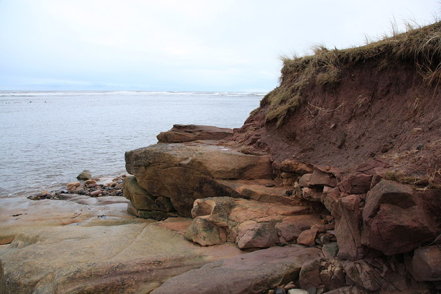 Sandstone cliff and regolith