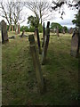 NY1750 : Gravestones leaning every which way by Matthew Hatton