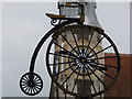 SY6990 : Dorchester: penny-farthing sign in Cornhill by Chris Downer