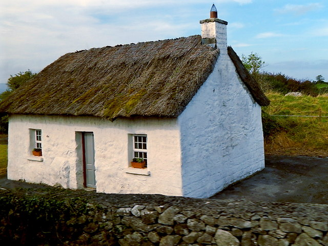 White Thatched-Roof Cottage along west side of N67 near Dunguaire Castle