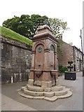 NT9953 : Fountain below the town wall by James Denham