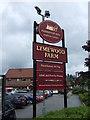 SJ5597 : Sign for the Lymewood Farm pub by JThomas
