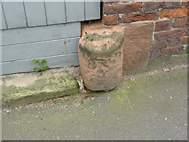 SK5855 : Bench mark, Carne, Main Street by Alan Murray-Rust