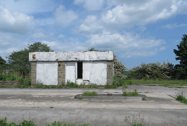 Derelict petrol station on the A689