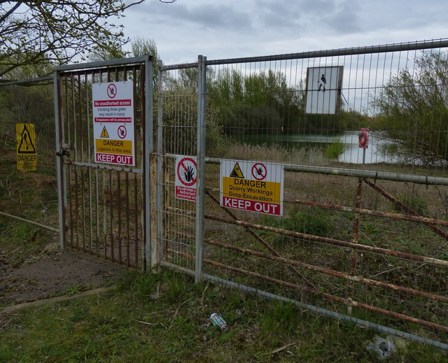 Blocked off entrance to a flooded gravel pit