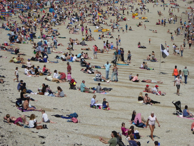 People on Gyllyngvase Beach Falmouth
