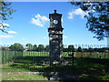 TQ7260 : The war memorial and clock tower at Eccles by Marathon