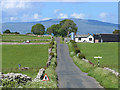 NY5619 : Bedlands Gate crossroads and farm by Oliver Dixon