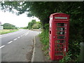 SY8787 : East Stoke: phone box at Stokeford by Chris Downer