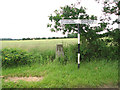 TF9906 : Triangulation pillar at rural crossroads by Evelyn Simak