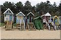 TF9045 : Beach huts with verandahs by Pauline E
