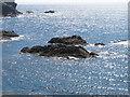SW8471 : Rocks outside Porth Mear by David Hawgood