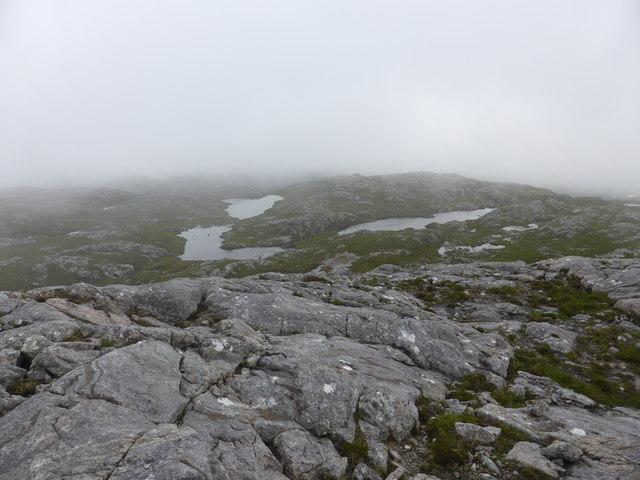 Three remote lochans in the mist