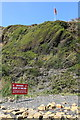SY9079 : Danger sign and flag, military firing range by Rob Noble