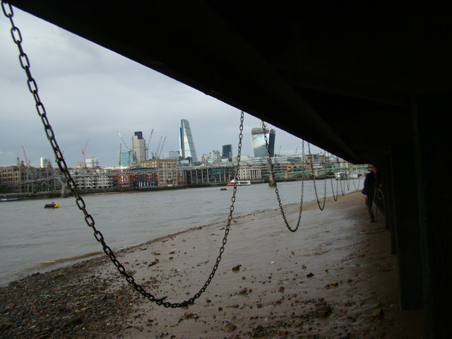 View of the chains hanging from the side of the South Bank from the Thames Beach #2