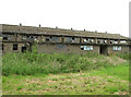TG1527 : Disused RAF-building in field by Evelyn Simak