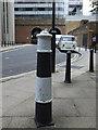 TQ3180 : Clink bollard by Stephen Craven