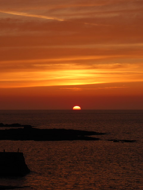 Sunset over the Cowloe rocks at Sennen Cove
