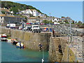 SW4726 : Boys jumping into Mousehole Harbour by David Hawgood