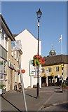 ST8993 : More signs than people in the Market Place Tetbury by Paul Best