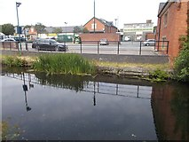 SJ2207 : Canal reflections by Morrison's car park by John Firth