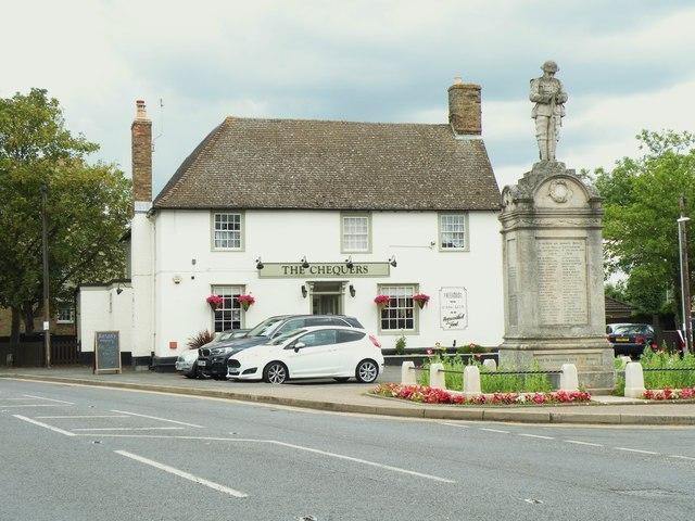 'The Chequers' inn and war memorial at Cottenham