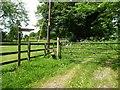 SU4839 : Footpath signpost and stile, north side, Hunton Lane by Christine Johnstone