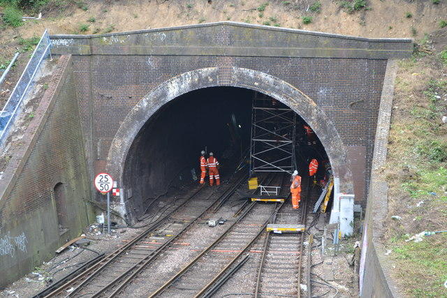 Engineering works in railway tunnel mouth