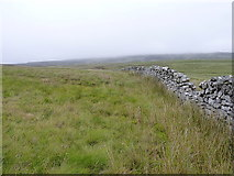 SH8040 : Drystone wall on the moors of Mochowgryn by Richard Law