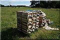 SE8044 : Boxes of Suspension Insulators  near Hayton Field Farm by Ian S