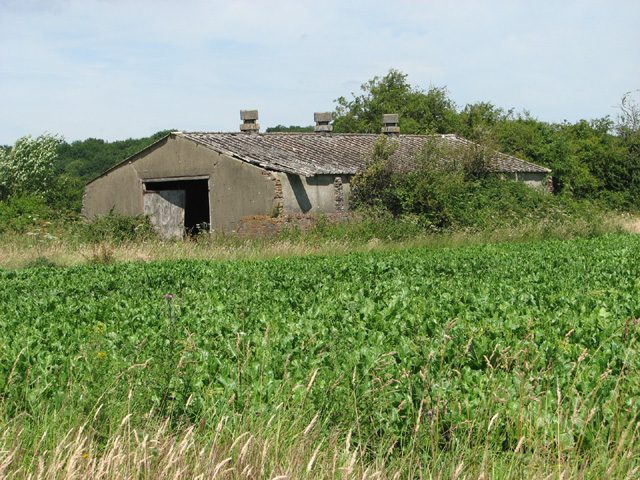 Old airfield building on a field boundary
