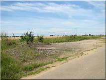 TF6304 : Remains of a hardstanding beside New Road by Evelyn Simak