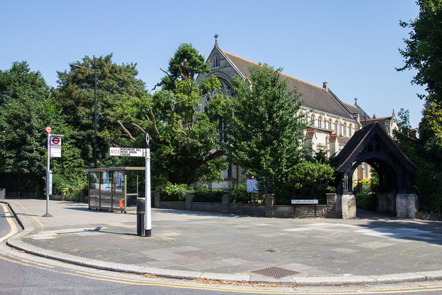 Finger post, bus stop and church