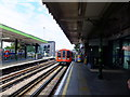 TQ4591 : Central line train approaching Hainault by Richard Hoare