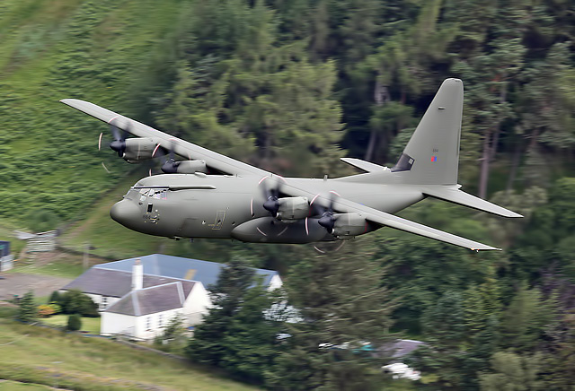A low flying RAF Hercules aircraft