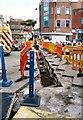 SJ8990 : Digging up Lancashire Bridge by Gerald England