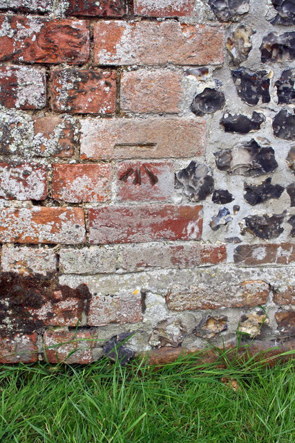 Benchmark on outbuilding of The Corner House