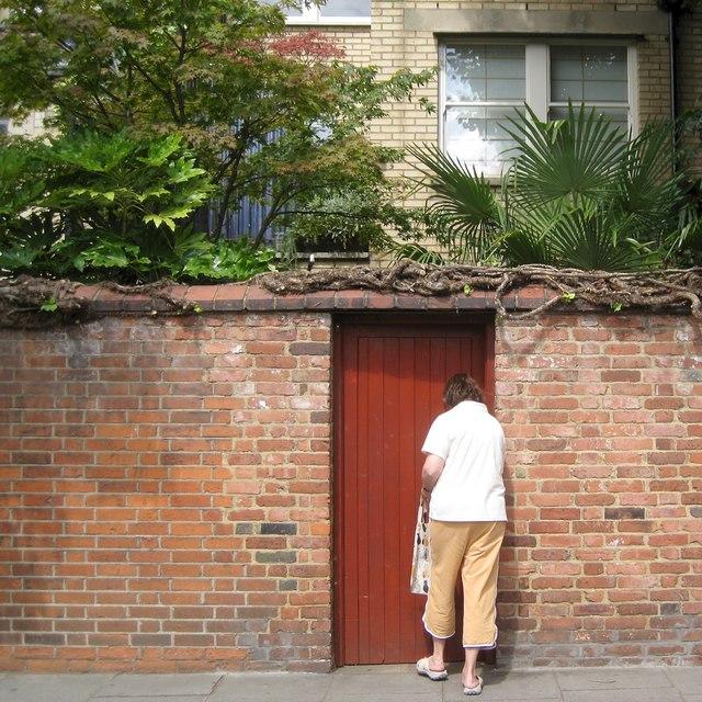 Opening a garden gate, Broadley Terrace