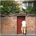 TQ2782 : Opening a garden gate, Broadley Terrace by Robin Stott