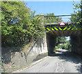 SU8999 : Nag's Head Lane passes under the railway by Stuart Logan
