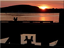 NM8529 : Oban: sunset over the ferry pier by Chris Downer