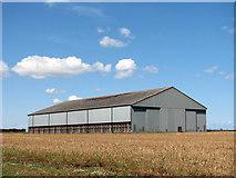 TF9038 : Hangar in crop field by Evelyn Simak