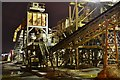 TQ4079 : Night view of aggregate conveyors at Angerstein's Wharf by David Martin