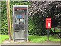 NU1912 : Post box and telephone box, West Acres, Alnwick by Graham Robson