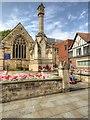 SK9771 : War Memorial outside St Benedict's Church by David Dixon