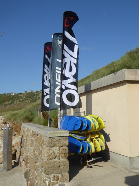 Banners and surfboards at Sennen Surf School