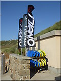SW3526 : Banners and surfboards at Sennen Surf School by Rod Allday