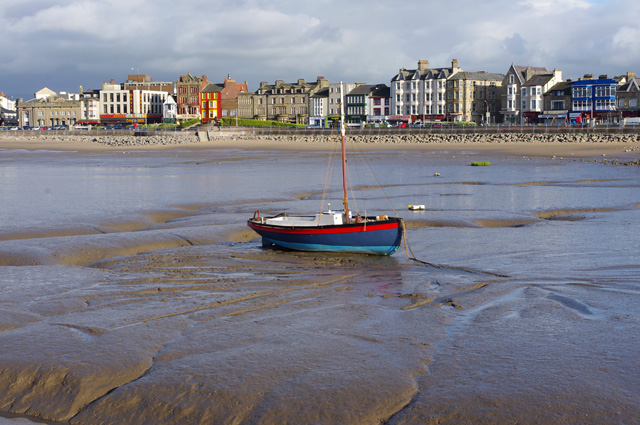 Wooden boat on the mud